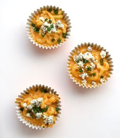 Here's a clever way to serve up M&C, like this Buffalo Chicken Mac and Cheese, to a crowd: Spoon mac and cheese into pretty cupcake liners and set out the individual portions for guests to pick-up. Click through for more delicious mac 'n' cheese recipes.