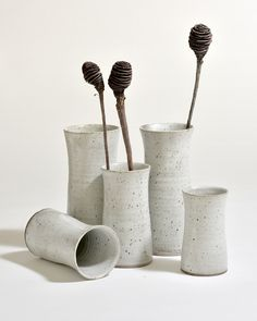 Exploring some pinched cylinders. Recycled clay with a satin white glaze.