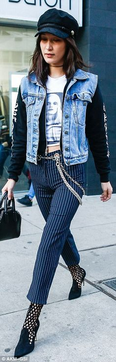 Well-heeled: Hadid rocked a pair of pinstripe trousers above her dramatic, perforated heel...