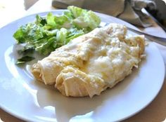 Simple Sour Cream Enchiladas    Ingredients:    4 chicken breasts, fully cooked & shredded    2 dozen white corn tortillas    1 16 oz. can green enchilada sauce    2 ounces additional green chiles    14 oz. sour cream    4 cups shredded cheese (Jack or Mexican blend)