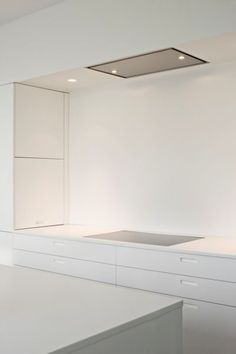 BOFFI 1-Pure and sleek white kitchen by Boffi_ 2-recessed fan? 3- beam over -up to ceiling- creates enclosed space