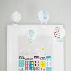 Video tutorial on how to make mini hot air balloons out of paper lanterns. Hang them separately or on a string of lights.