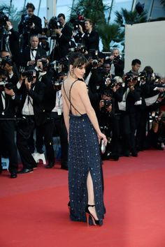 Milla Jovovich exudes both oomph and style in her backless gown.