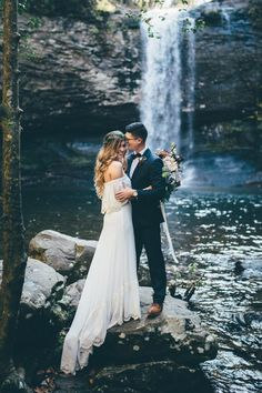 Our breaths have been stolen by this waterfall moment from this stylish couple's Georgia wedding | Image Amber Phinisee Photography #weddingphotography