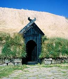 Viking age in Iceland. Looks to be an entry to a long house. The long house 'empty' __ looks awful. When the community was inside, there were a couple fires going, Soup going, music played, people working on Weaing. For the beds, drapes on cubby beds, walls (keep cold out) for pillows, long pillows for huge built in bench, children playing, sleeping in Fur Skins, The quest for survival made it a hearty culture of equality, hard work, and party hard. ;-D to this day