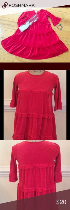 """Hanna Andersson Girls Size 130 (8) Velour Dress Here is a girl's red tiered stretch velour dress by Hanna Andersson in size 130, approximately a size 8. Tiers of soft velour adorned with tulle ruffles cascade into a full A-line, perfect for twirling! Bracelet sleeves. Pre-loved with no stains or holes. Cotton/Poly blend, made in Ukraine. Chest measures 30"""" just under arms, length from shoulder to hem is 29"""", arm length is 13"""". Listing is for the dress only; accessories shown are styling…"""