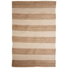 crafted in an easy-care combination of jute and wool, this natural reversible fiber rug in gold has earned its stripes.