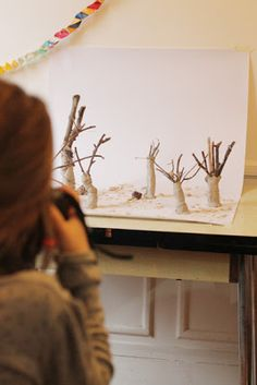 atelier pour enfants: This looks like such a cool art school! The children create animals and a forest setting, then photograph them. And the photos will be made into a book.