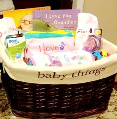 """Is there a soon-to-be grandma in your life? Get her the perfect survival kit to help her love and care for her new bundle of joy. This listing is for a grandma's survival gift basket, filled with all the essentials a grandma could want and use. It includes a small pack of diapers, wipes, (2) pacifiers, a bottle, a rattle, a small toy, a swaddle or burp blanket, an """"I love Grandma"""" onesie, bib, and book."""