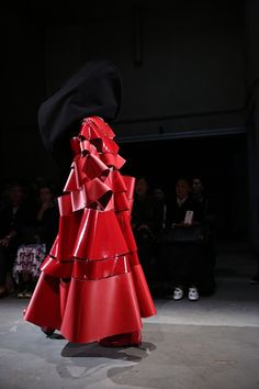 Hidden under red leather at Comme des Garçons SS15 PFW. More images here: http://www.dazeddigital.com/fashion/article/21972/1/comme-des-garcons-ss15