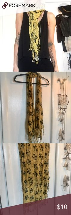 Mustard Scarf With Fleur De Lis Pattern Name sorta says it all! This is a thin knit scarf, nice and long and super soft with fringe on the ends. It is mustard color and has a black fleur De lis pattern all over it. It's from urban outfitters originally. Urban Outfitters Accessories Scarves & Wraps