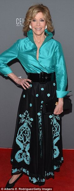 silk teal blouse/full length black skirt with teal hued floral print, cinched at waist with black patent leather belt ... worn by Jane Fonda