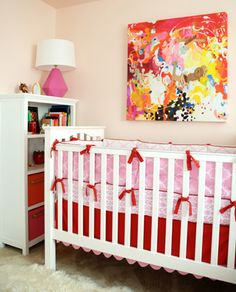 Great to see abstract art over the crib in this colorful nursery! {Love the @LandofNod In the Mix Crib Bedding}