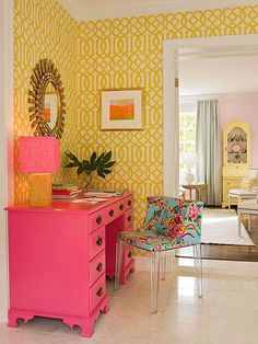 A+yellow-on-yellow+lattice+wallpaper+makes+this+office+space+unforgettable,+as+does+the+bright+pink+desk+and+chic+accessories.+The+vibrant+colors+work+together+because+each+one+can+be+found+in+the+fabric+on+the+desk+chair.