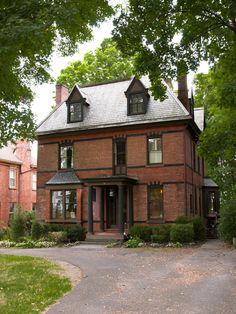 Calvert Vaux designed brick house in Kingston with original olive, black, and maroon color scheme. Design Sponge.
