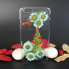Pretty Daisy Dried Pressed Flowers Cell Phonecase for iPhone 5. Material: Plastic, Dry flower, Resin. Durable,flexible and not easy to fly off. Transparent and good for protect your phone. Handmade items with excellent quality. Please contact us if you have any question.
