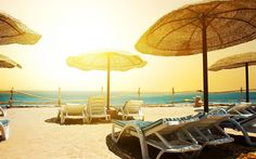 Download wallpapers sea, beach, chaise lounges, waves, umbrellas near the sea, rest, travel concepts