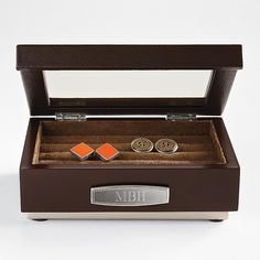 Monogrammed brown cuff link display case from RedEnvelope.com would make a great gift for the man who has lots of cuff links.  It also does a great job holding rings and stud earrings.