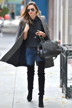 Miranda Kerr in a tweed coat and suede thigh high boots tucked into her jeans // Style 101: How to Wear Your Jeans with Boots