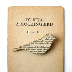 Finch Brooch, created with the pages of To Kill A Mockingbird.  Let's hope the artist did not pull a page from a First Edition.