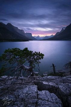 Twilight falls at Glacier National Park's St. Mary Lake by Alex Noriega