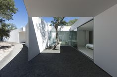 Completed in 2015 in Grândola, Portugal. Images by Juan Rodriguez. Among the pines trees, a stone plateau is drawn to a scale that can no longer be understood as a courtyard. The space embraces a wide area of trees. ...
