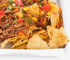 Slam-dunk Pulled Pork Nachos Tender, seasoned Pulled Pork makes the perfect topping for cheesy nachos. Give them a creamy, spicy twist – serve with prepared Epicure's Chipotle, Bacon & Cheddar Dip! Healthy Gluten Free Recipes, Clean Recipes, Real Food Recipes, Yummy Recipes, Sweet Potato Skins, Mashed Sweet Potatoes, Tapas, Health Meal Prep, Cheesy Nachos