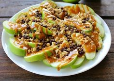 Caramel Apple Nachos.  3 Apples, peanut butter or caramel sauce, Hershey miniatures, white or chocolate melting wafers (or Hershey bar), and chopped peanuts (optional)