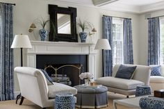 Living Room: A Blue and White Living Room is accented with a Black Mirror. The space feels calm and coastal.
