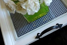 Take a large picture frame, put scrapbooking paper or fabric under the glass, and add drawer pulls to each end. Makes a beautiful tray! Lemon Tree Creation