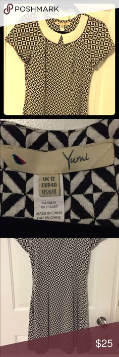 Women's Dress Yumi Retro In size 6/8-NWOT This is a Yumi retro designer dress in size US 6/8. It was never worn, just the tags taken off!  This dress will look great with high heels for an evening out!  It comes from a smoke free home! Yumi Kim Dresses Mini