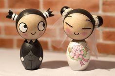 Pucca and Garu inspired kokeshi dolls. A wedding cake topper. Custom order.