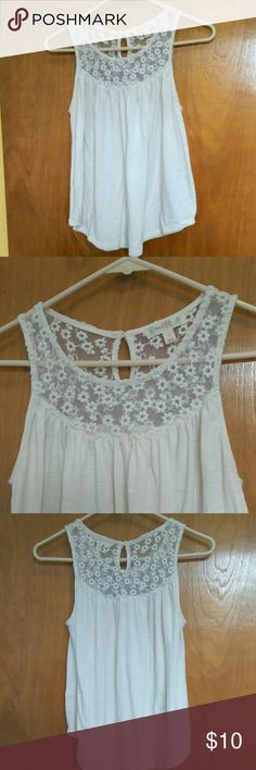 "White, lace topped, tank top. It's a white, lace topped, flowy top. The lace is a floral print. It's a keyhole button closer in the back. There's no stains and in great condition! The brand is ""love fire"" the size is small love fire Tops Tank Tops"