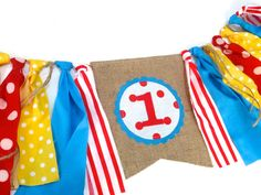 CIRCUS Birthday Banner Highchair High Chair Garland Primary Color Red Aqua Yellow Carnival Picnic One First Party Cake Smash Photo Prop by SeacliffeCottage VINTAGE CIRCUS Birthday Banner with Rag Tie Garland in red, aqua, and yellow Love this colour combination! Vintage Circus inspired birthday banner. Double layer burlap flag with hand cut appliqué and number Aqua, Red and Yellow Polka Dots, Red/White striped, Twine rag ties accent the banner. Would you like a different age on the banner…