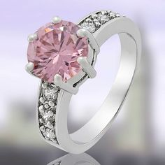 'Size 8 Pink Sappire 18K WGP Ring' is going up for auction at 10pm Wed, Nov 7 with a starting bid of $7.