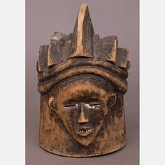 LOT 314 A PUNU TRIBE CARVED WOOD MASK Dimensions: H: 17 W: 11 D: 11 Est: $150-250 	  An African Punu Tribe Carved Wood Double Face Helmet Mask, Gabon, 20th Century.