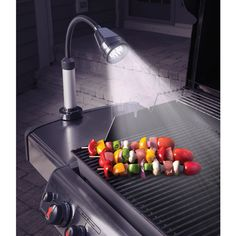 This lamp that clips onto the grill for middle-of-the-night kebab sessions. | The 17 Most Dad Things That Ever Dadded