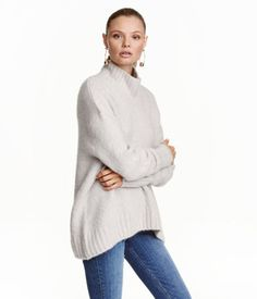 $35 Light gray melange. Wide-cut knit sweater in a soft wool blend with a ribbed turtleneck. Dropped shoulders, long sleeves, and ribbing at cuffs and hem.