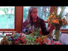 How-to make a full, abundant harvest arrangement with mums, ferns and other fall flowers. #fall