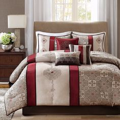This comforter set includes seven items and features a modern colorblock look with embroidered taupe pattern details. Choose either red or blue bold stripes that draw the eyes into this beautiful comforter.