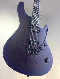 "Mayones Regius 6M V24, Maple Burl top, Trans Dirty Purple Blue Burst Satine finish, Mahogany Khaya body wings, 11-ply 'Exotic II' Mahogany / Maple / Padouk / Wenge neck-thru-body section, Trans Natural Satine back finish, Ebony fingerboard, 16"" fingerboard radius, 25.4"" scale, 24 Ferd Wagner medium jumbo frets, Abalone 5 mm front dot markers, Abalone 2 mm side dot markers, 3-ply Black ABS / Black Acrylic Pearl binding, DiMarzio Air Norton® DP-193 H-H set, Electroswitch Electronic Products…"