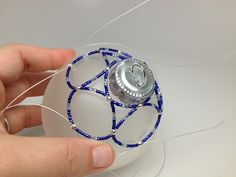 Beaded ornament-- We received some gorgeous ones for Christmas. A family favorite! Hope I can try to make one some time.