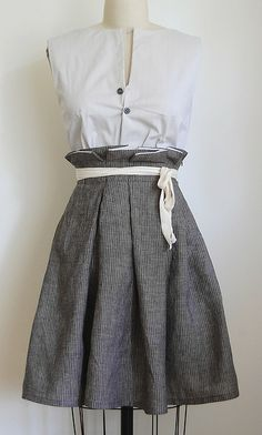 Love the skirt and really like the idea of those criss crossed buttons!