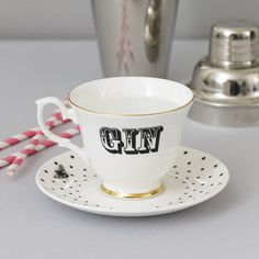Unique and quirky Gin tea cup and saucer with beautiful gilt gold detailing.    A fun and fabulous design which is perfect for wowing guests at your