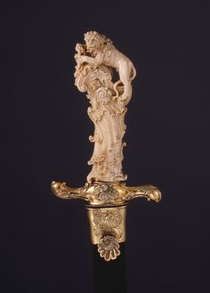 Hunting Sword, ca. 1740–50  Ivory grip attributed to Joseph Deutschmann (1717–1787)  German (possibly Munich)  Steel, silver-gilt, ivory, leather    L. 29 1/2 in. (74.9 cm)  Gift of Jean Jacques Reubell, in memory of his mother, Julia C. Coster, and of his wife, Adeline E. Post, both of New York City, 1926