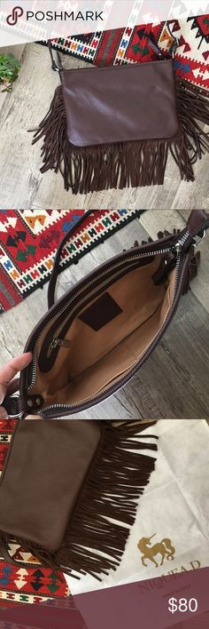 Chocolate Italian Leather Fringe Crossbody Bag NEW This small Italian leather fringe purse is amazing! Bohemian goes Beverly Hills! Rich chocolate brown, soft supple & slight pebble textured leather with suede fringe. Stately silver hardware. NEW never used but no tags. Boutique line Nique'D of Papyrus. No mistaking the luxe quality of this bag. If you want this look and you're over 20, don't settle for a cheap one - this is your bag! Dust bag included. Measurements shown and provided on…