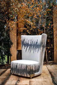 When we were asked by a leading manufacturer of fabrics in Lake Como to design a Club Chair for Art Basel, we decided to have a classic modern look design adding a brass leg and highliting the hand work of the fabrics with the reproduction of Gregory Robin Primordial Vibration Painting. www.robicara.com