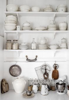 Shabby kitchen and shelves with white ironstones