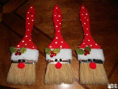 """Santa Ornaments out of Paint Brushes.  Supplies:  2"""" paint brushes. Red craft paint. White craft paint. Black 5mm Pom Poms for the eyes or use wiggly eyes. Red 9mm Pom Pom for the nose. Fleece for hatband. Artificial holly & berries or 3D holly & berry stickers for hat adornment.  Instructions:  Paint your paint brush red; let dry and paint on white polka dots. Cut a strip of fleece wide enough for hatband and wrap around brush, gluing to keep in place. Add eyes and nose. Add holly and…"""