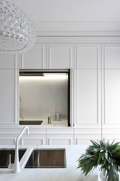 "Is it a minimalist's dream kitchen or the lazy cook's ultimate ""shove the mess behind the ..."